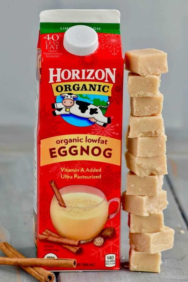 Horizon's Eggnog is standing next to a stack of Eggnog Fudge.