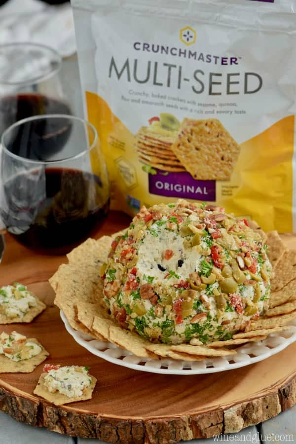 The Olive Cheeseball surrounded by the Multi-Seed Crackers.