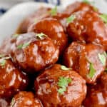 a pile of instant pot cocktail meatballs garnished with parsley