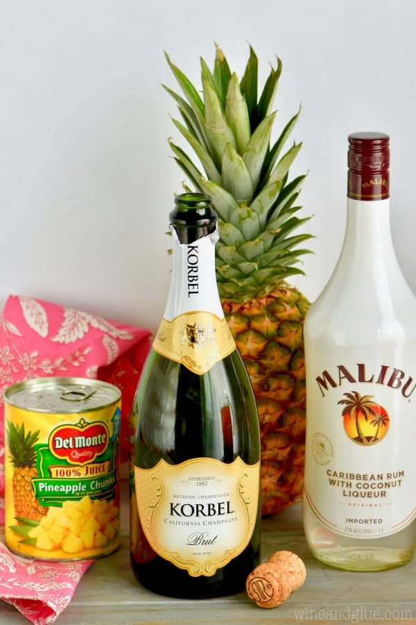 A picture of the ingredients (pineapple chunks, Champagne, and Caribbean Rum with Coconut Liqueur)