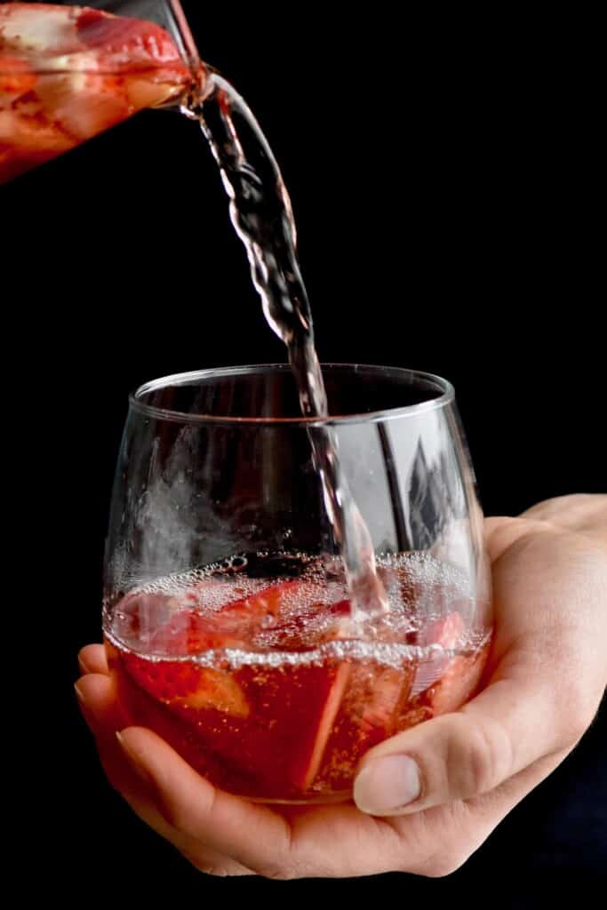 rose sangria being poured into a glass