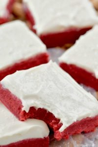 red velvet bar, frosted with cream cheese and a bite missing