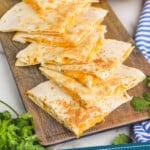pinterest graphic of triangles of Taco Bell quesadillas on a platter