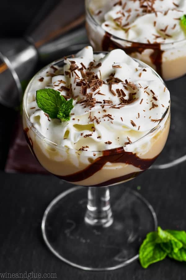 chocolate baileys martini in a small glass garnished with chocolate shavings and whipped cream.