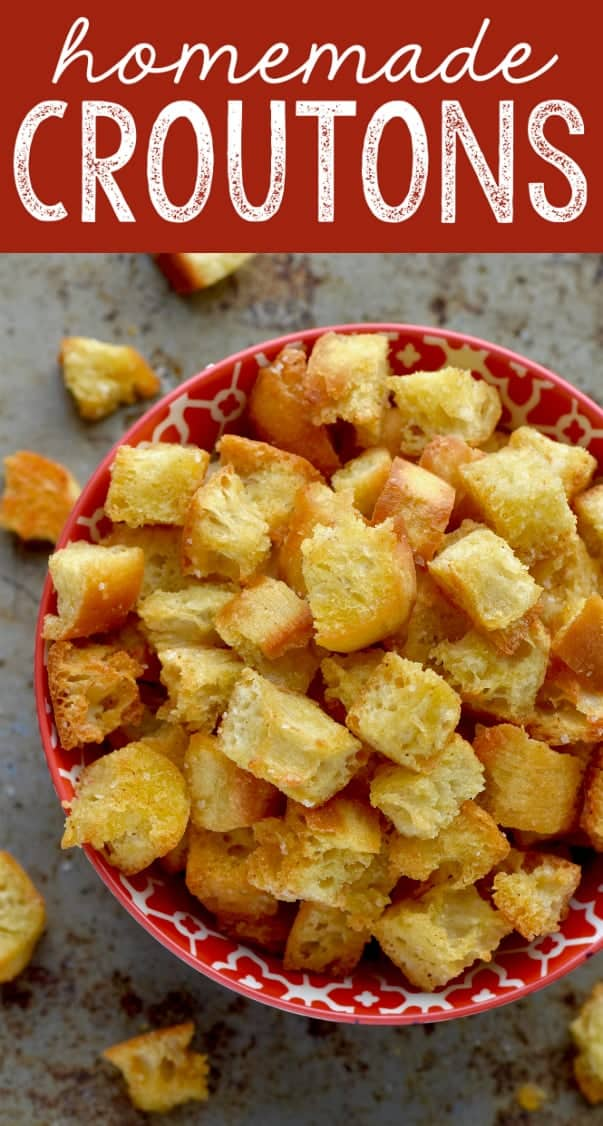 An overhead photo of the Homemade Croutons in a red bowl.