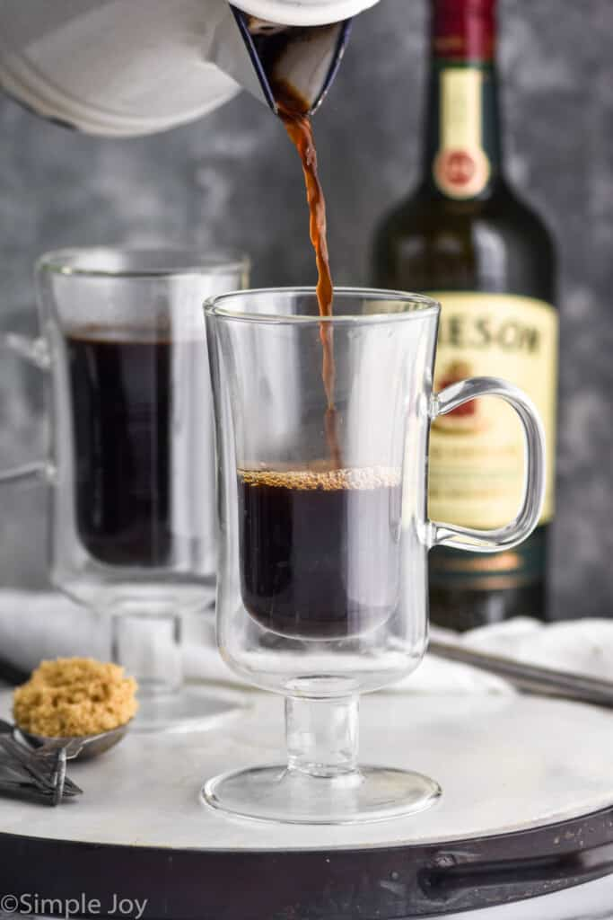 coffee being poured into an Irish coffee mug