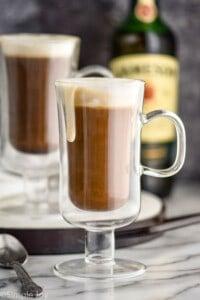 Irish coffee in Irish coffee mugs with cream dripping down the sides