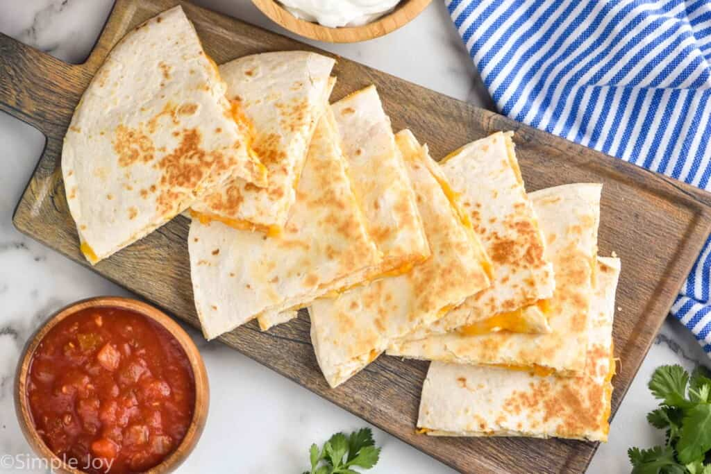 overhead of a platter of chicken quesadillas