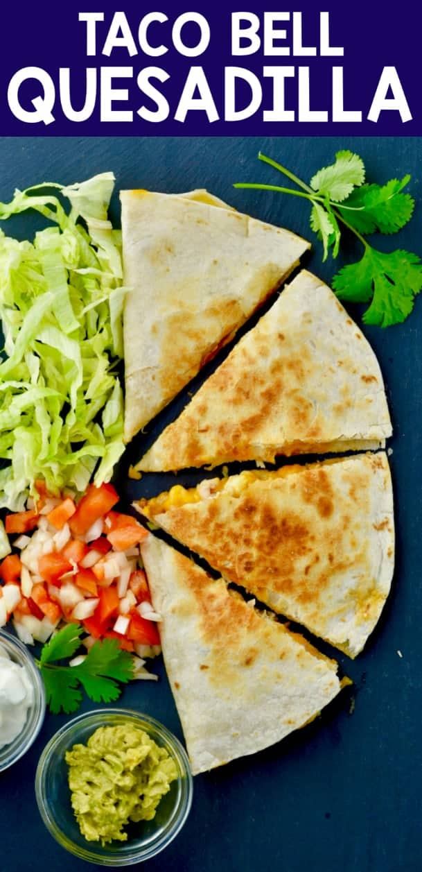 A overhead photo of the Taco Bell Chicken Quesadilla with a side of pico de gallo, guac, and sour cream.