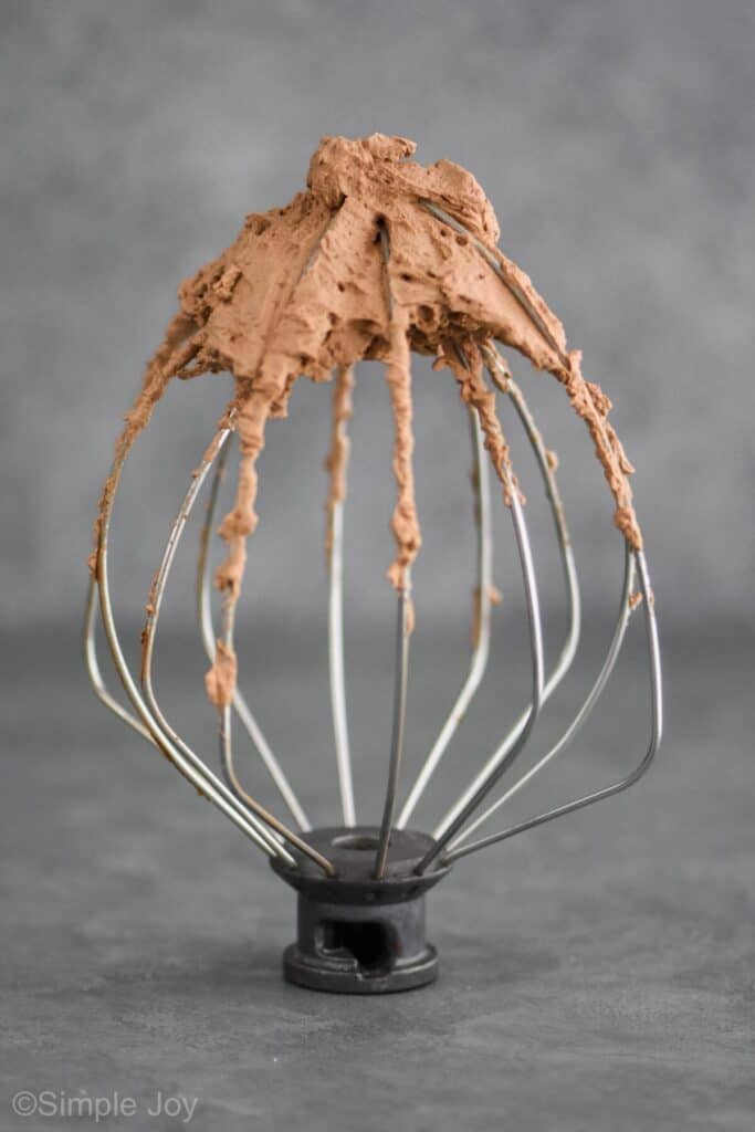 chocolate whipped cream recipe on a beater that is standing up