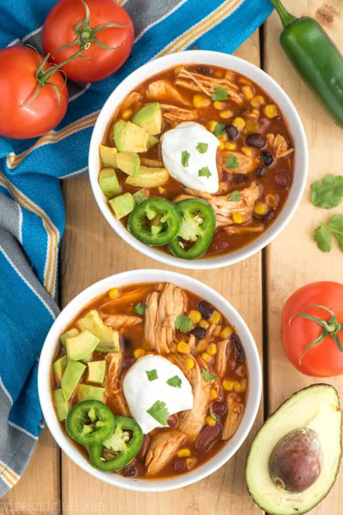 overhead shot of two bowls of instant pot chicken taco soup recipe with sour cream and jalapeños