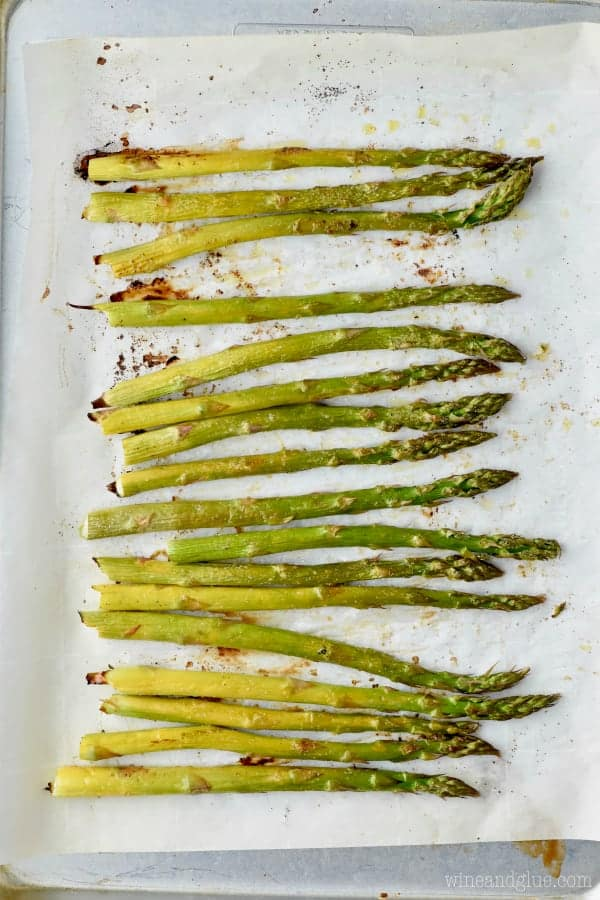 roasted asparagus on a pan with parchment paper
