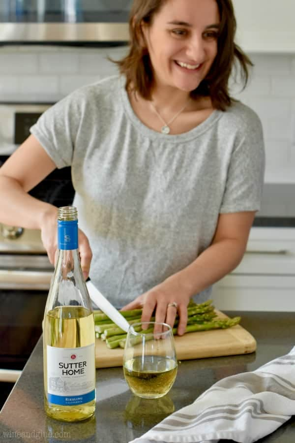 wine bottle with woman chopping asparagus