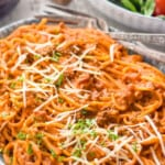 pinterest graphic of side view of a platter of instant pot spaghetti