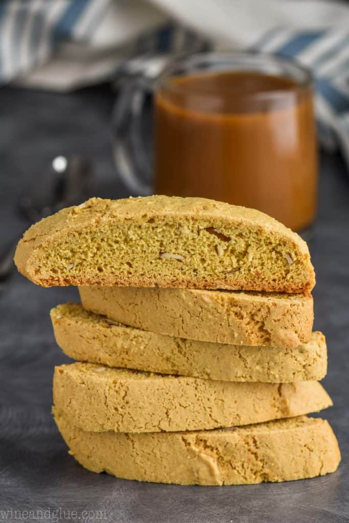 stack of biscotti cookies with coffee in the background