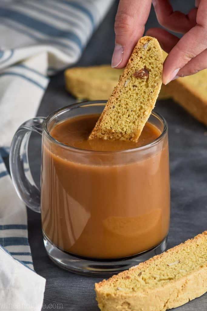 biscotti being dipped into coffee