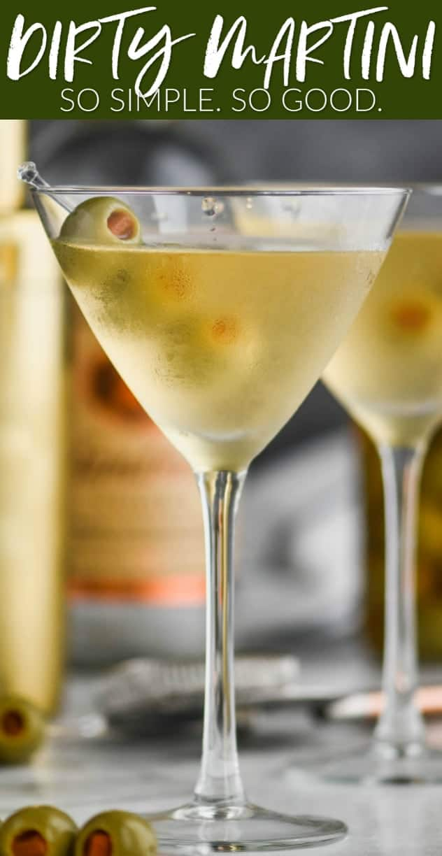 straight on view of a frosted martini glass with a dirty martini in it, garnished with three olives