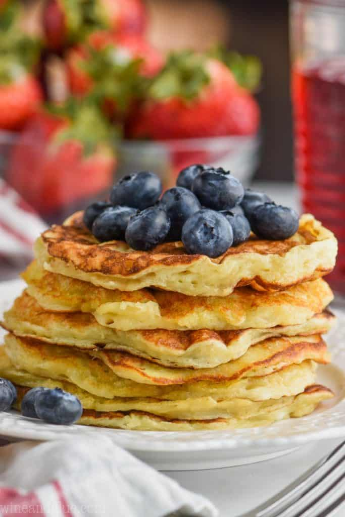 front close view of stack of yogurt pancakes topped with fresh blueberries