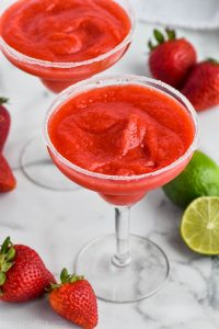 traditional margarita glass rimmed with sugar and full of strawberry margaritas