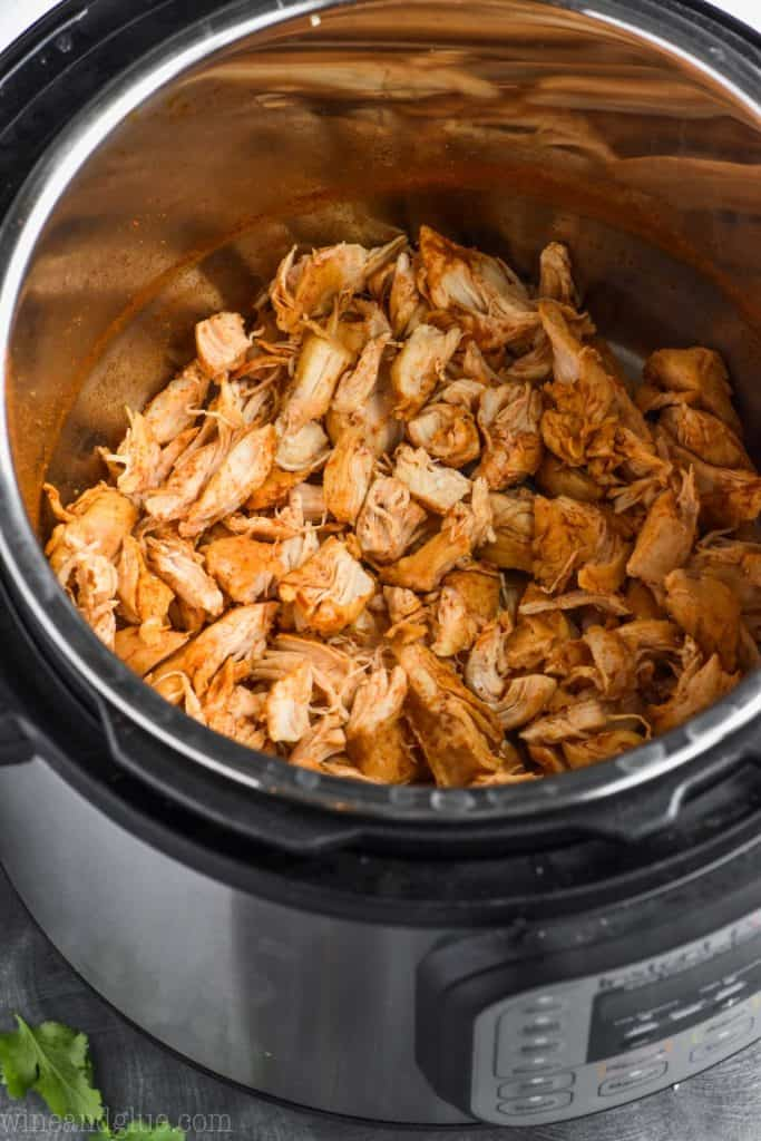 overhead view of taco chicken in instant pot