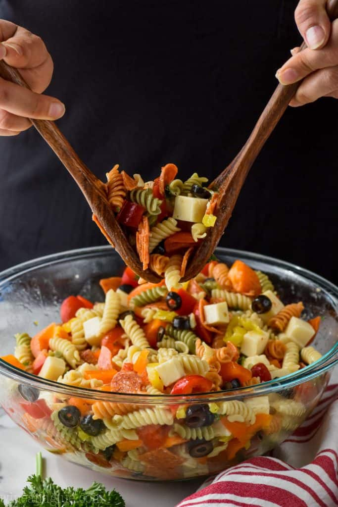 cold Italian pasta salad being tossed