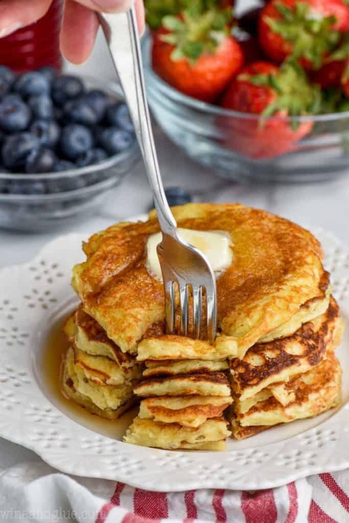 stack of basic yogurt pancakes with fork getting biteful