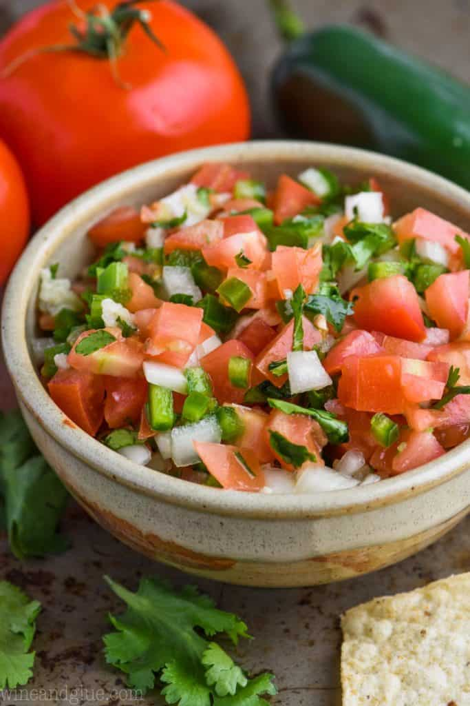 A small bowl of Pico de Gallo garnished with cilantro