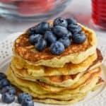 pile of yogurt pancakes with fresh blueberries on top