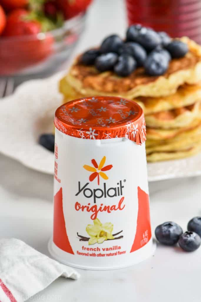 container of 6 ounce Yoplait Original with pancakes in the background