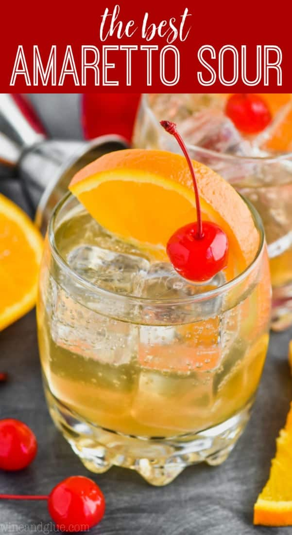 an amaretto sour recipe in a glass with a cherry and orange