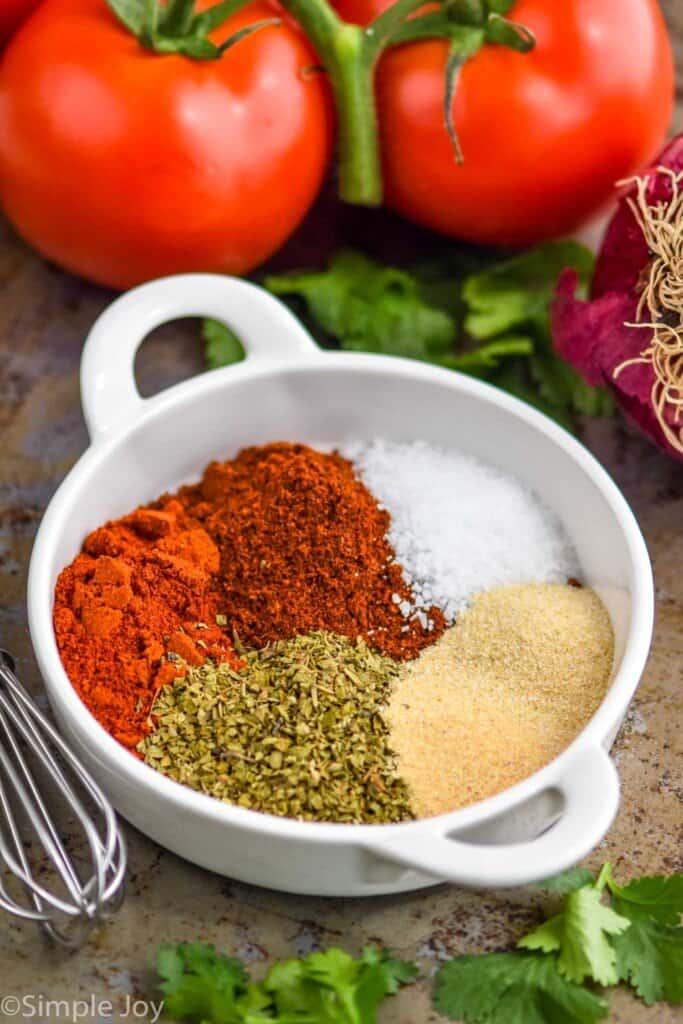 fajita seasoning recipe broken down by ingredient in a small white dish