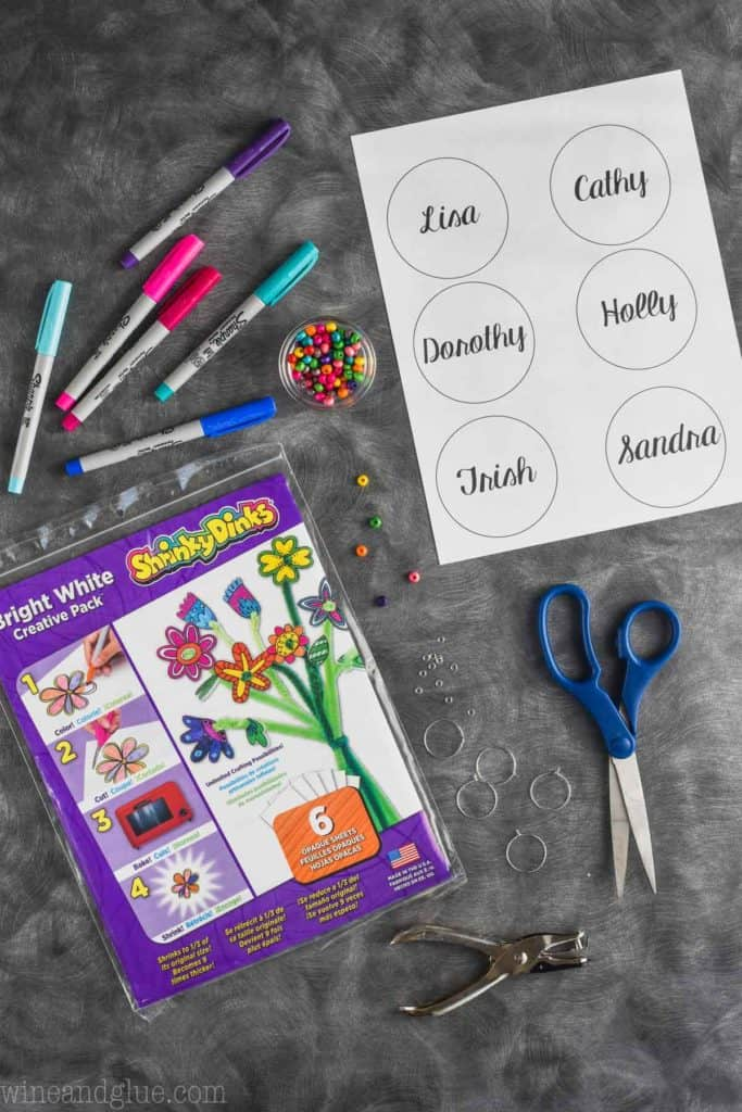 sharpie markers, shrinky dinks paper, template, and scissors for homemade wine charms
