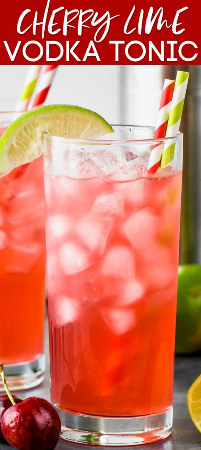 up close view of a high ball glass filled with ice and cherry lime vodka tonic and garnished with a lime wedge