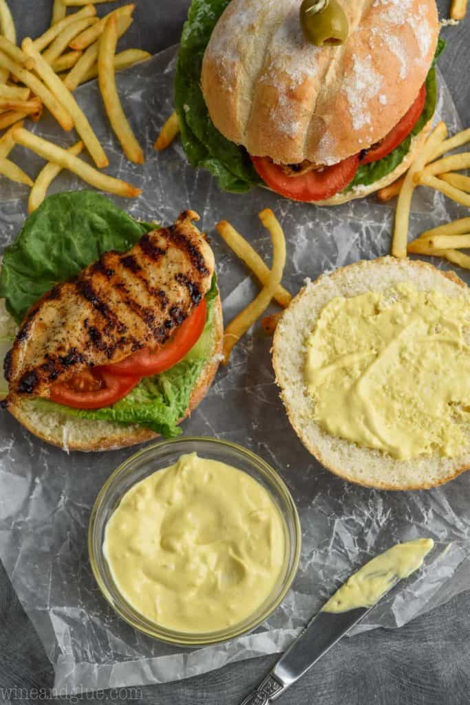 open grilled chicken sandwich with garlic mayo mustard spread