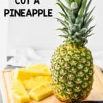 a whole pineapple on a cutting board waiting t be cut