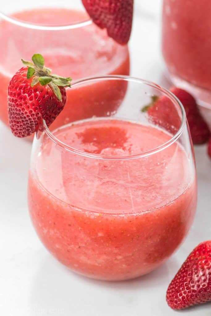 glasses of Strawberry Wine Slushies with a slice of strawberry on the glass