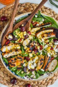 overhead photo of cherry and easy corn salad recipe with grilled chicken and cheese