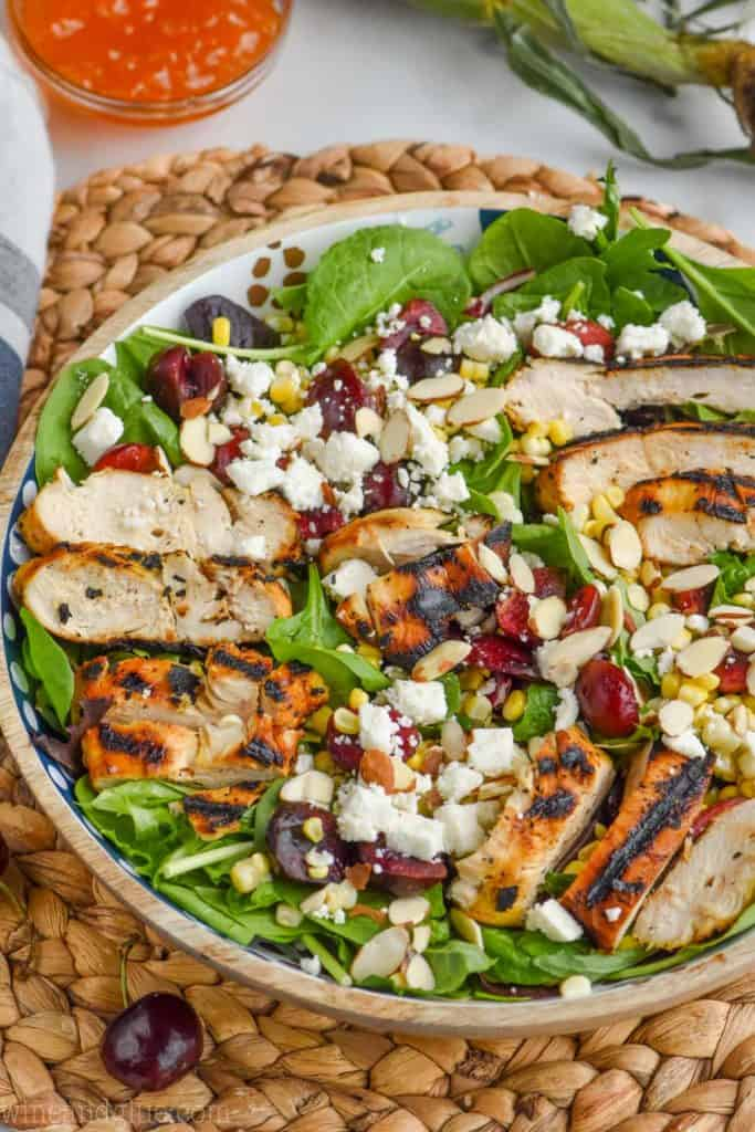 easy corn salad recipe with chicken, cherries, and almonds