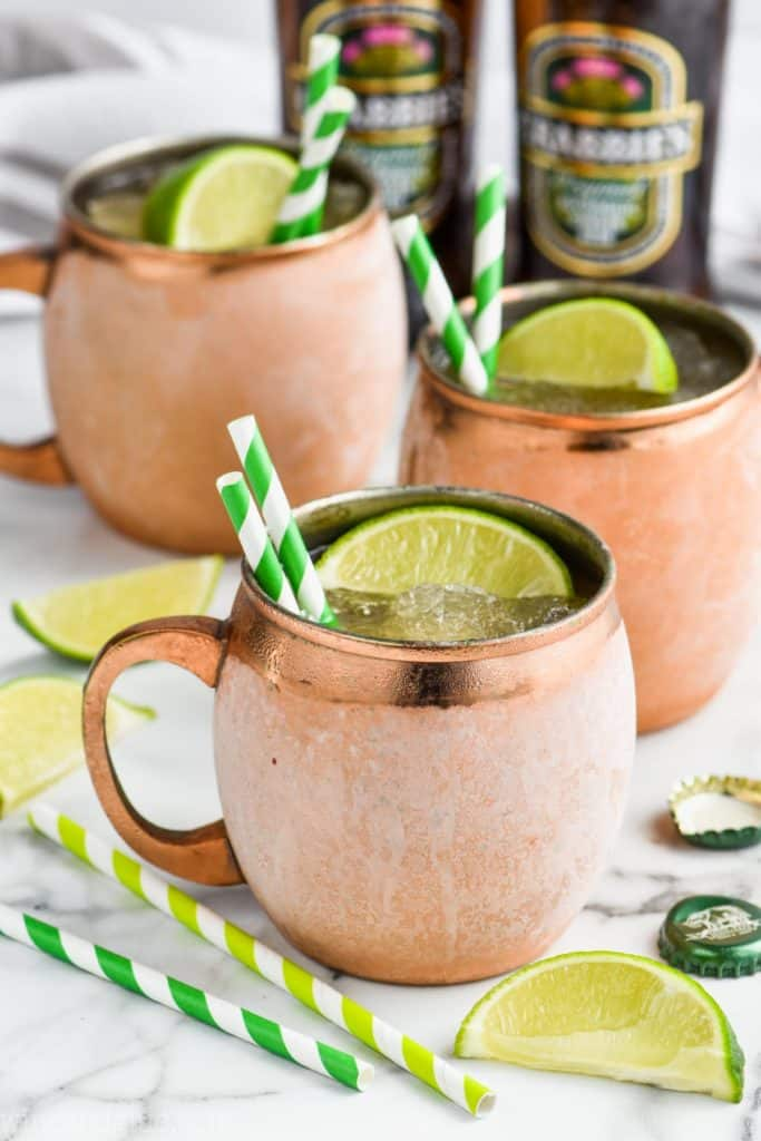 frosted copper mugs holding frozen moscow mules