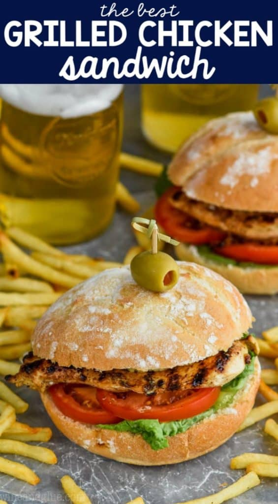 grilled chicken sandwich recipe on a bun with an olive and toothpick and fries around it