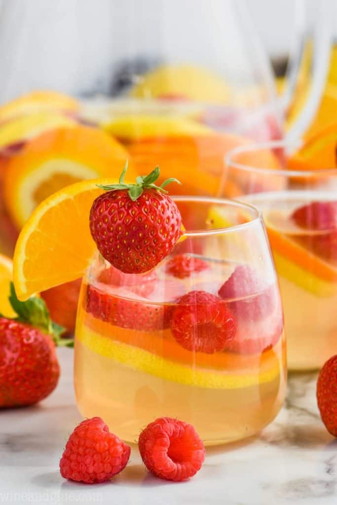 glass of easy white sangria recipe with strawberry and orange
