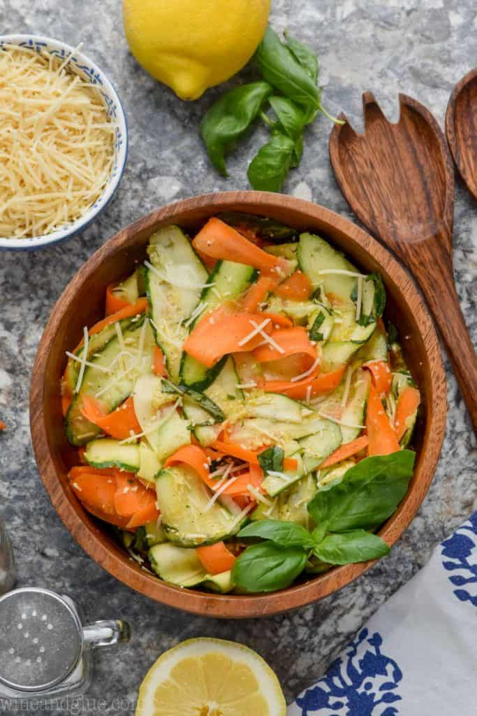 overhead view of marinated zucchini salad in wood bowl