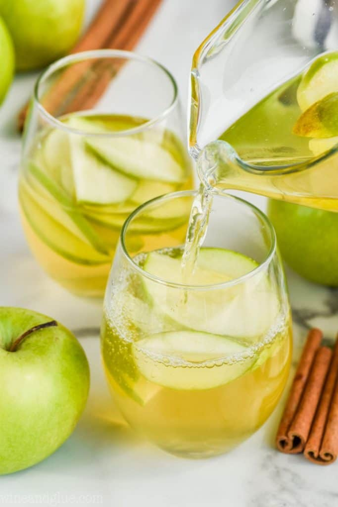 apple pie sangria recipe being poured into a glass