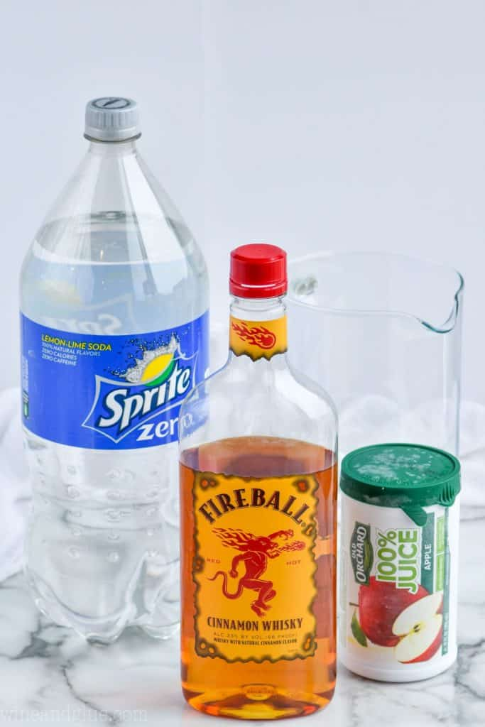 ingredients (Sprite zero, Fireball, Apple Juice) for fireball whiskey punch
