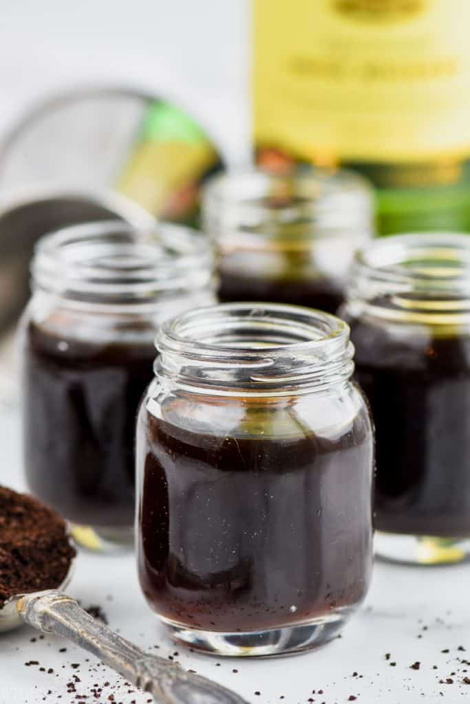 irish coffee shots in mason jar shot glasses before being topped with whipped cream