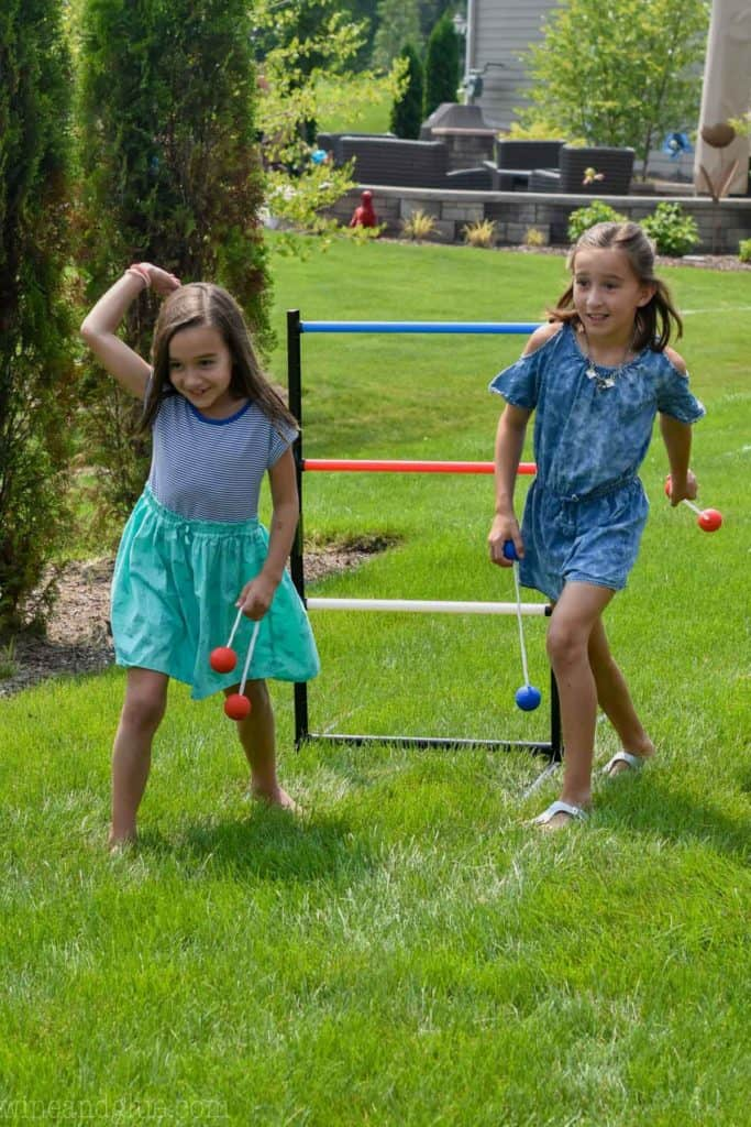two kids play ladder ball