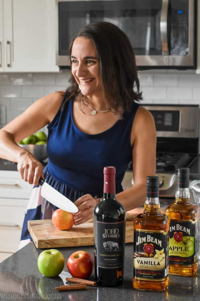 woman cutting up an apple for apple pie sangria