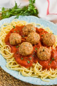 the best turkey meatball recipe on a bed of sauce and spaghetti
