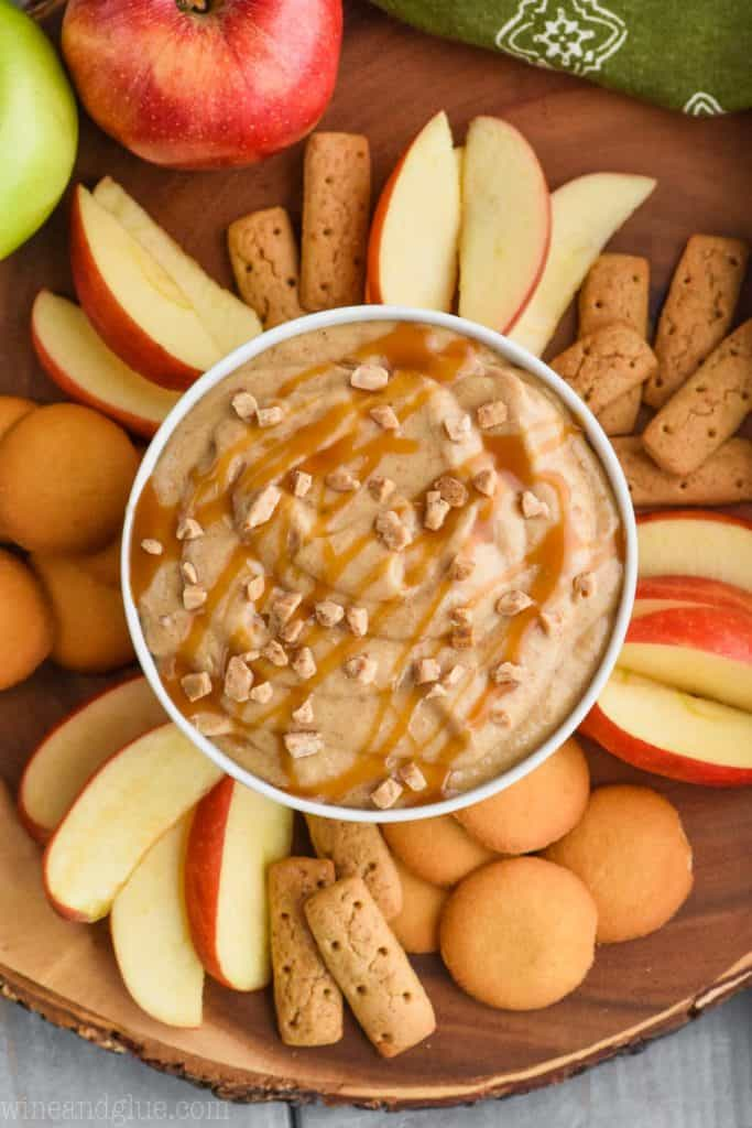 overhead view of caramel apple dip recipe with apples, cookies and crackers