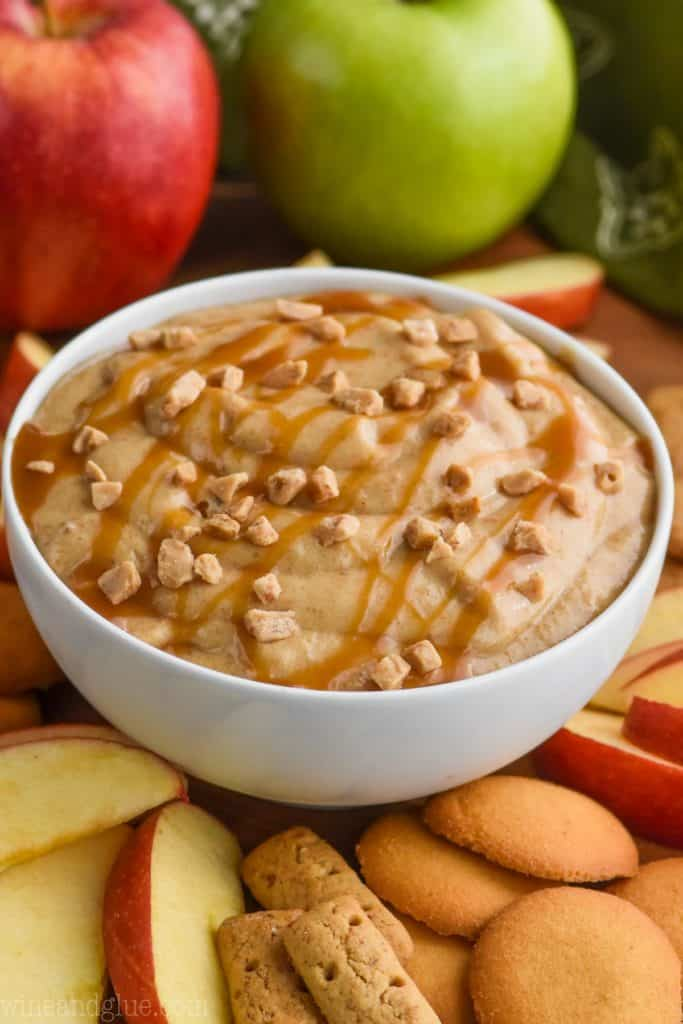 easy caramel apple dip in a white bowl with toffee bits